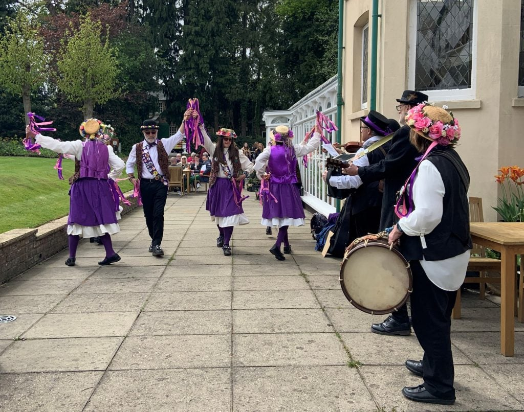 Morris dancers on the terrace at Reveley Lodge during the May Day celebrations in 2019.