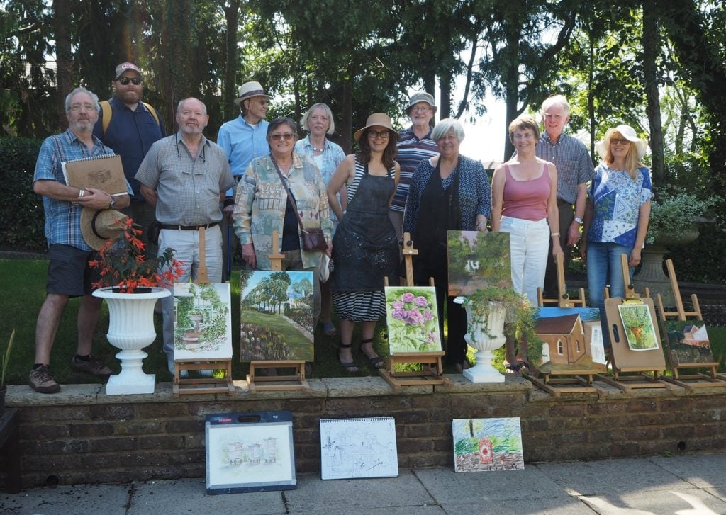 Artists showing their artwork from the Artist's Challenge in 2018.