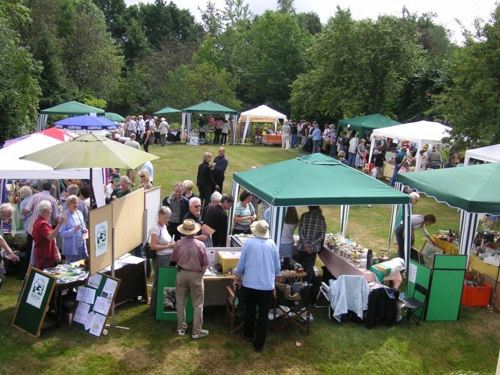 Stalls on the main lawn at the summer fair.