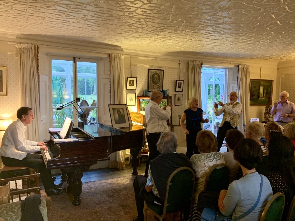 The Bushey Waits performing in a parlour concert in summer 2019.