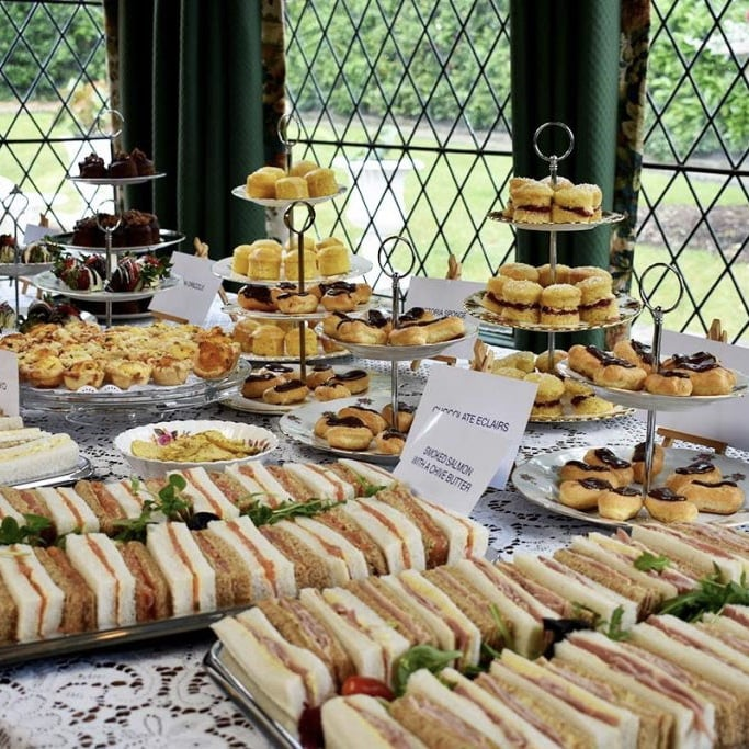 Sandwiches and cakes on display at Mabel's Vintage Tearooms.