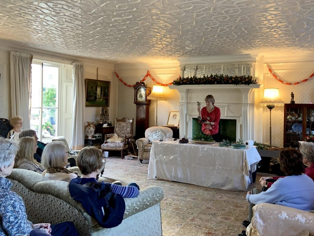 Christine Ramsey giving a Christmas flower arranging demonstration in the drawing room.