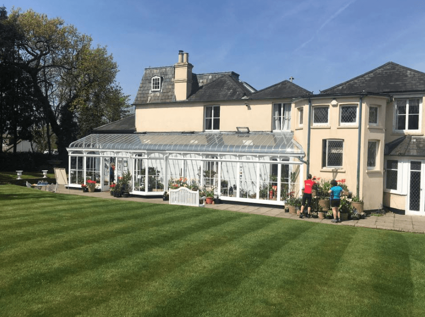 The main lawn and terrace at Reveley Lodge.