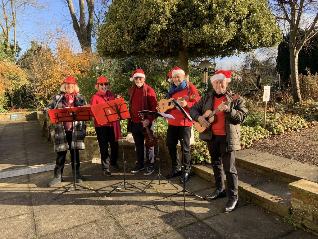 The Bushey Ukelele Group performing on the terrace at the Christmas Fair.