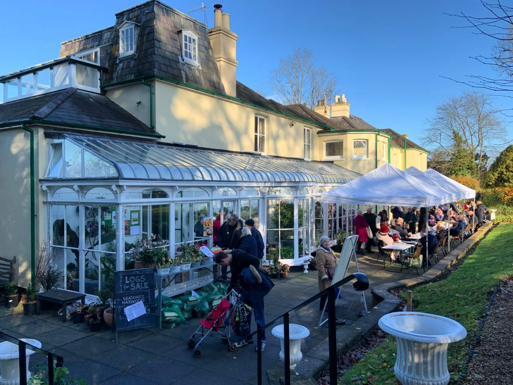 People on the terrace at Reveley Lodge during the 2019 Christmas Fair.